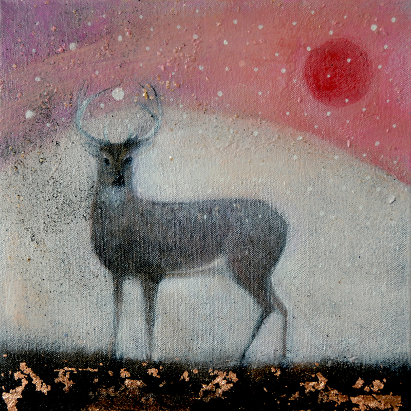 stag against snow and red moon