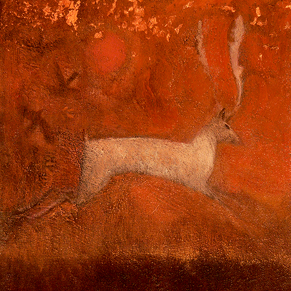 white stag in golden mist